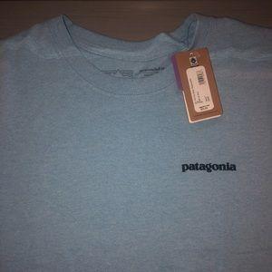 Light blue Patagonia t-shirt